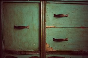 3 cupboards, green front with handles